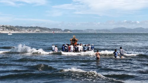 the group carries the tomb to the sea to purify the sacred spirit