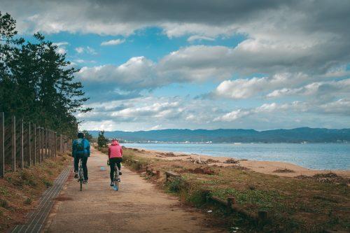Cycling along the bicycle path on Toyama Bay.