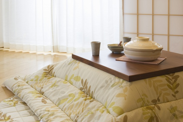 Kotatsu , a low and wooden Table Frame covered by a Futon