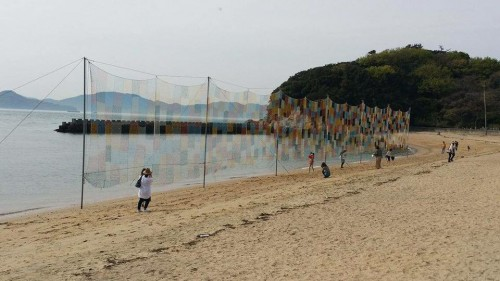 art on Honjima in Setouchi Japan , during the festival open seasons, the volunteers are busy doing all kinds of interesting work