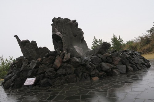 Sakurajima Portrait of a scream, an art monument screaming up towards the island volcano