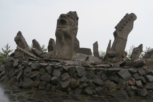 Sakurajima Portrait of a scream close-up, eerie art monument against island calm