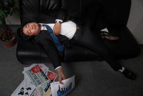 Japanese person resting after work in a situation you might say otsukaresama for doing good work.