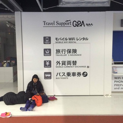 Some people slept near the baggage-weigh stations and ticket kiosks in Narita airport Japan