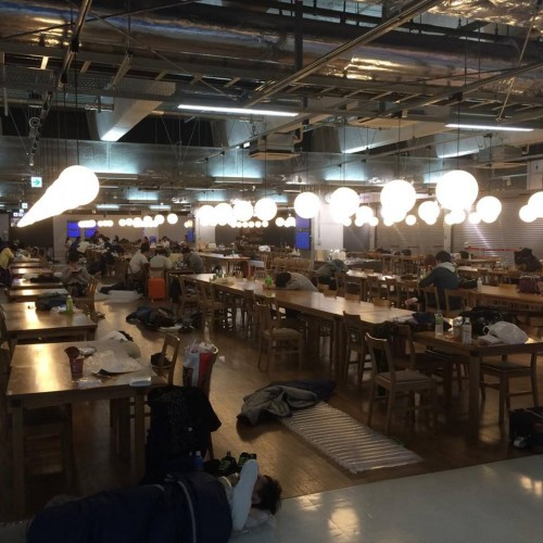 people sleeping in the food court of Narita airport Japan