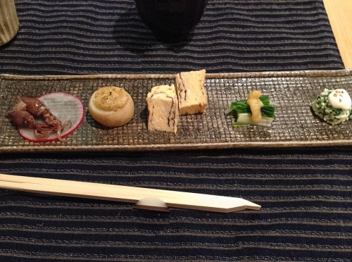 Kaiseki third course: squid, potato, egg, vegetables, and spinach.