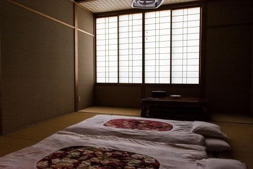 Futon sets on tatami room at Minshuku Takimoto on Sado island, Niigata, Japan