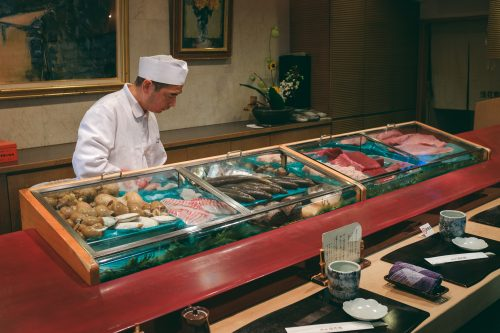 A chef prepares seasonal seafood from Toyama Bay into sushi