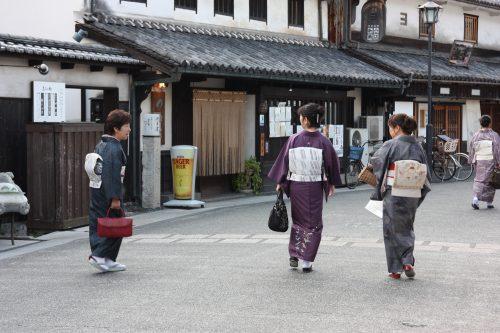 Strolling the streets in kimono in Bikan historic distict of Kurashiki, Okayama.