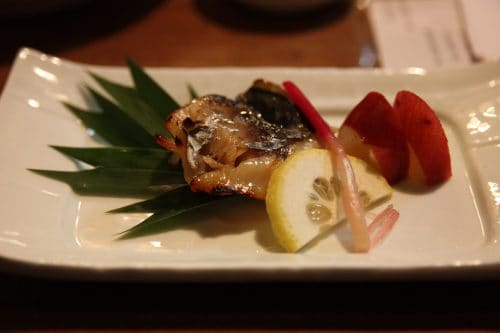 Beautifully presented dishes at Mingeichaya, an izakaya restaurant in Kurashiki, Okayama.