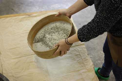 Sifting the soba flour for homemade soba noodles.
