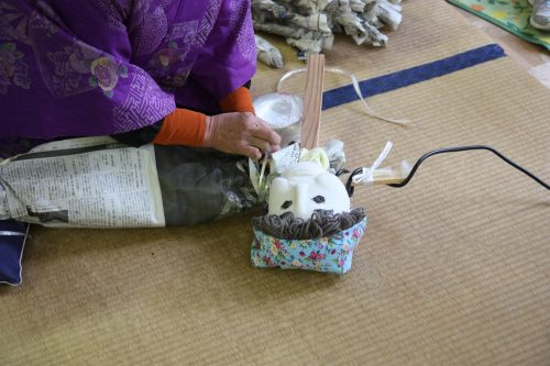 Mrs. Tsukimi, the creator of Nagoro's scarecrow population demonstrates her craft.