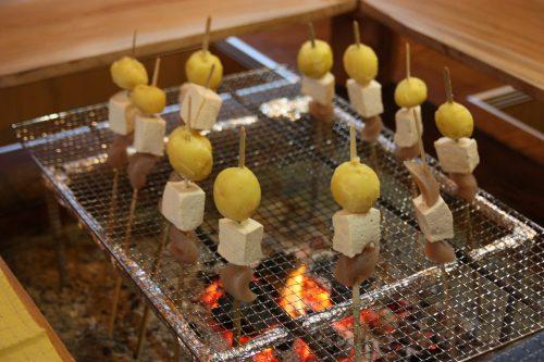Grilling skewers for dinner at Yuzu No Sato minshuku in Mima town, Tokushima, Shikoku.