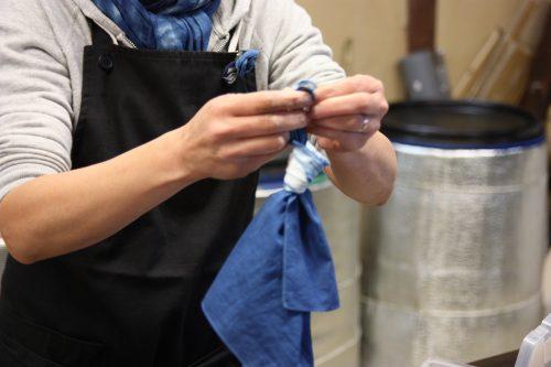 An indigo dyeing craftsperson in Udatsu.