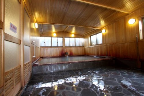 A relaxing bath at Sukayu onsen, Aomori prefecture in the Tohoku region, Japan.