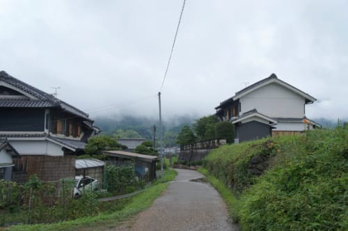 A small road bordered by traditional houses in Asuka