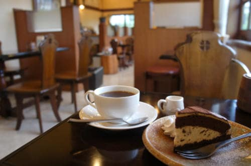 Coffee and chocolate pastry at Café Misono, in a dark wood decor