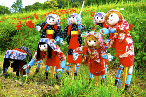 Colorful scarecrows in Inabuchi Tanada rice fields in Asuka, Nara