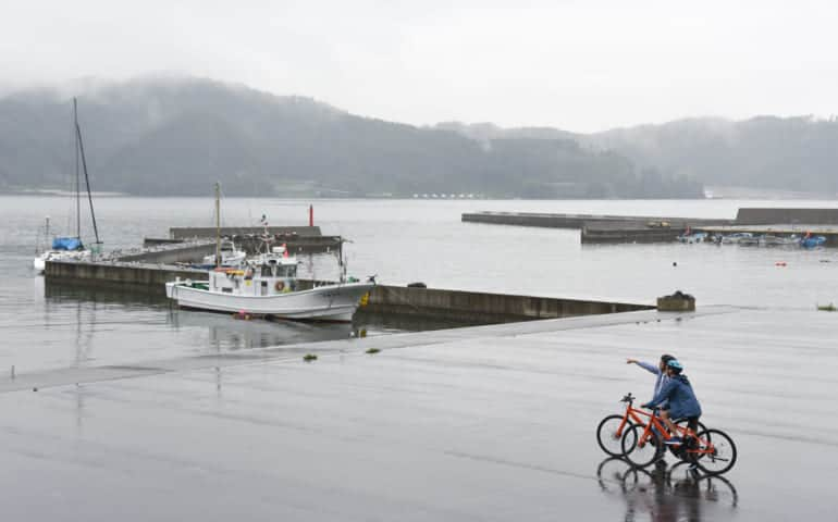 Cycling along the coast of Kamaishi City.