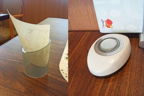 Botón y cuenta de un restaurante familiar japonés.
