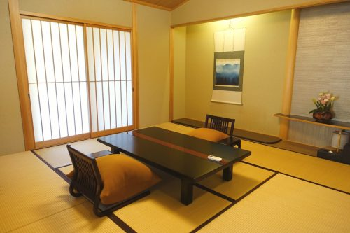 Living area of a room at Ryokan Shinsen in Takachiho.