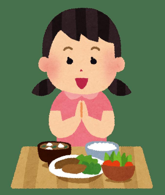 Bambina che dice itadakimasu prima di mangiare