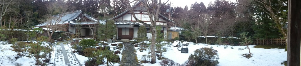 snow covers the trail and temple when Hiking Arashiyama