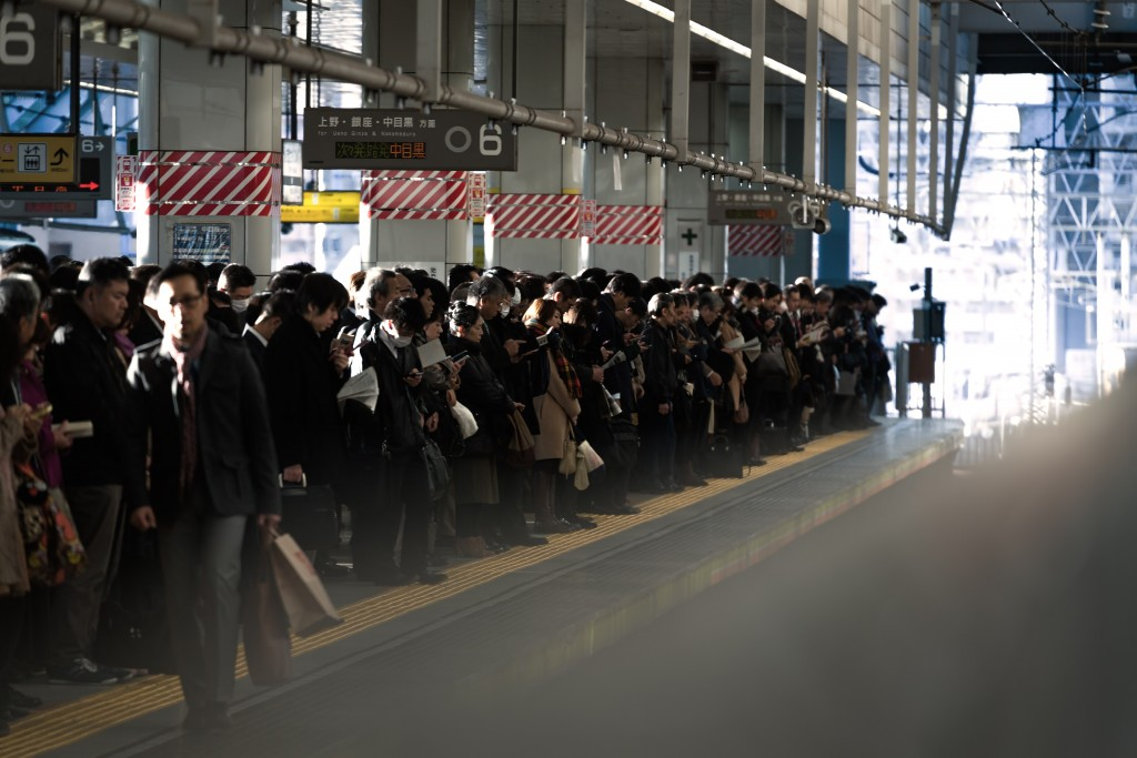 Japanese trains and stations , people gather in lines