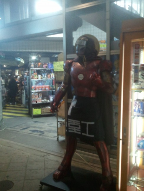 giant toy figure in Osaka's Den Den Town offering a variety of anime goods