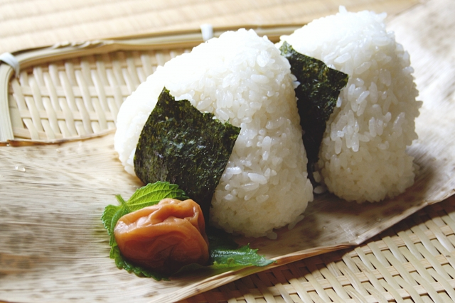 The onigiri, which is rice wrapped with nori, served with umeboshi
