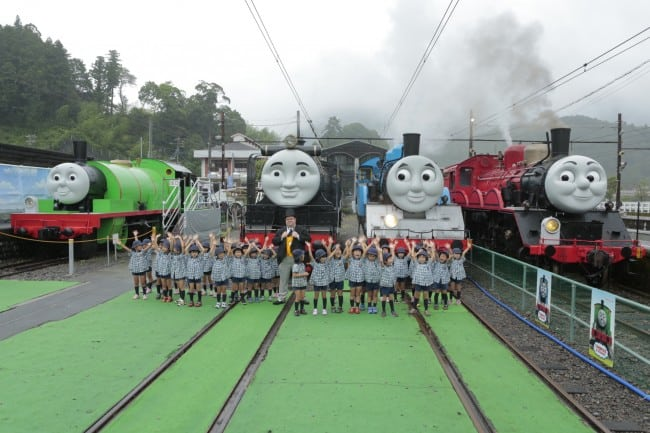 children group around with Thomas the train and friends in Shizuoka Oigawa Railway in Japan