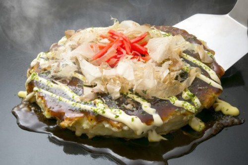 You should visit Kansai region in which okonomiyaki has origin if you're obsessed with authentic Japanese cuisince