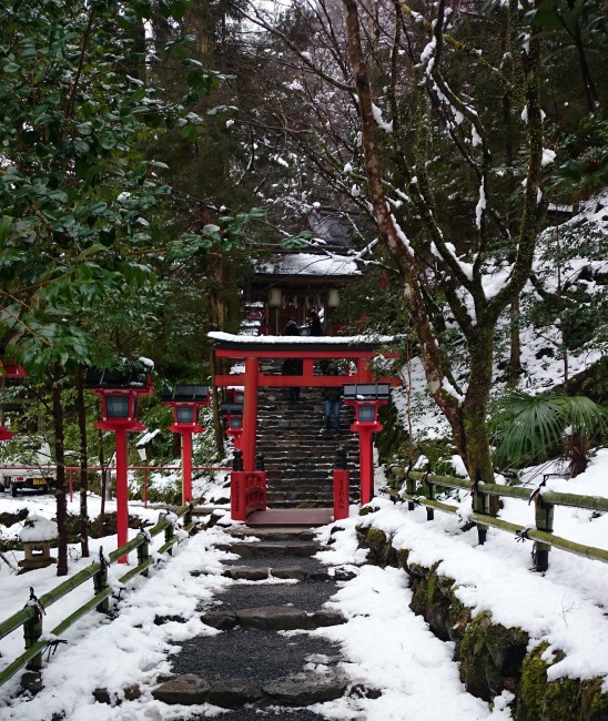 Entrance of Kifune Shrine surrounded by nature and snow