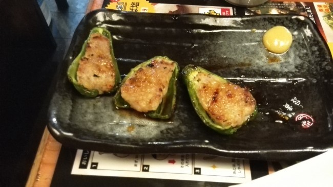 Green peppers packed with ponzu sauce and chicken (ピーマン肉詰) at Torikizoku, a popular Japanese Izakaya