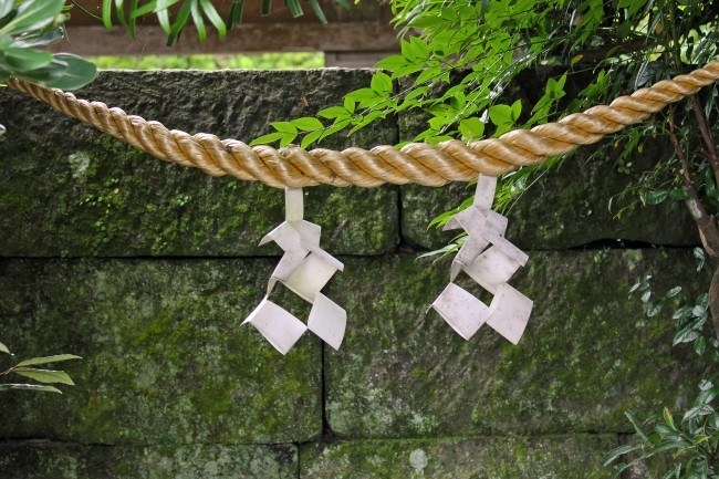Good luck charms hanging from a rope at the heritage samurai village of Chiran.