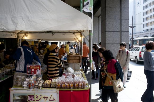 a small plaza near Kamitori Shopping arcade in Kumamoto features local farmers selling fresh produce
