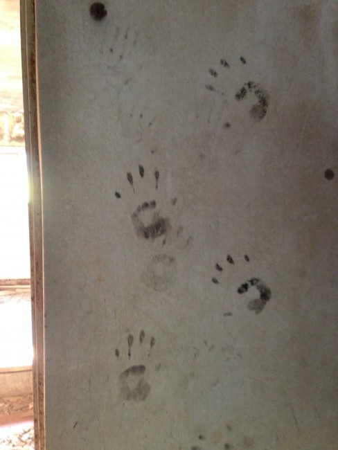 Handprints on a wall at Matsuo Kouzan town.