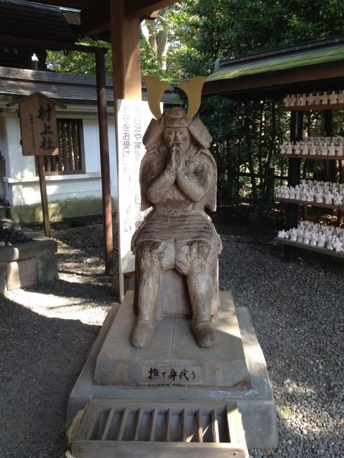 sitting samurai statue in a shrine