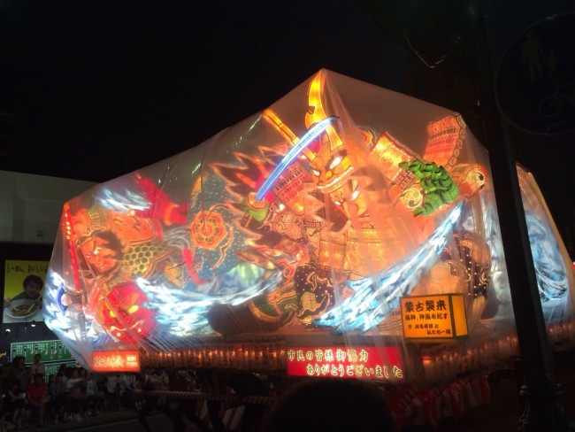A colorful glowing float at the Nebuta Matsuri Festival.