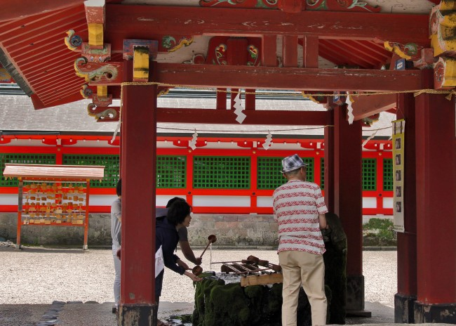 Cleansing area with holy water at Kirishima Jingu Shrine.