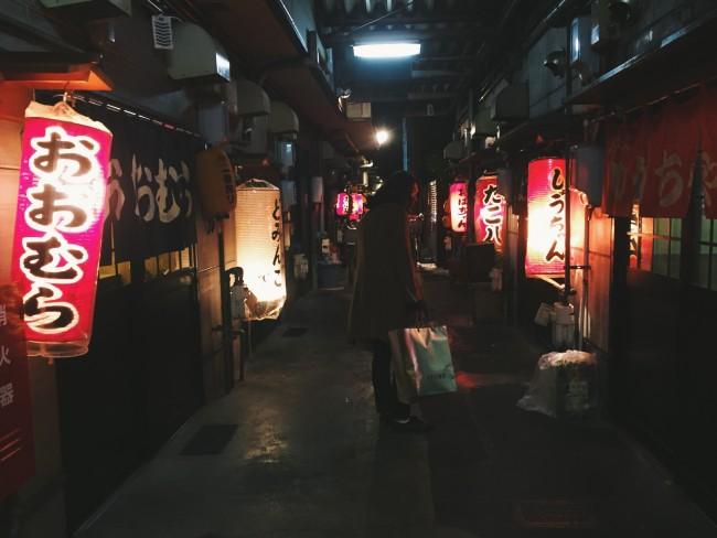 red lanterns illuminate the sliding doors leading into the oden shops in Shizuoka Japan