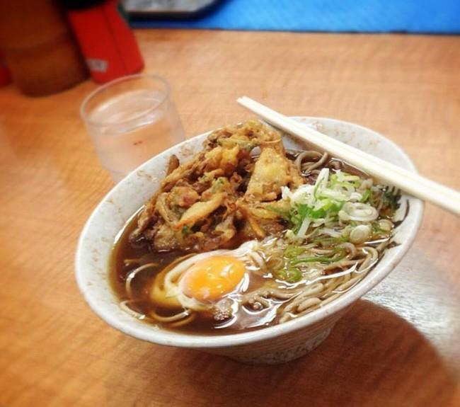 A delicious ramen noodles dish on a tachigui noodles stand restaurant countertop, Osaka