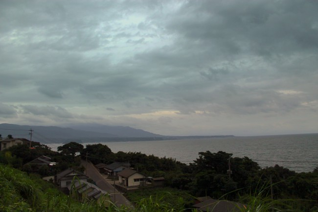 Houses of Sakurajima with nature of the island and water in surrounding.