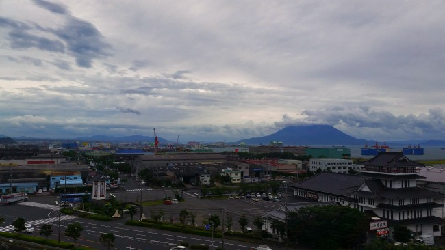City scenery with a little nature on the island of Sakurajima with the volcano in the background.