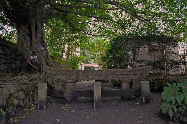 Shrine related object on the island of Sakurajima with nature all around.