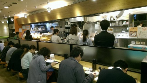Japanese people at the counter of Hanamaru Udon.