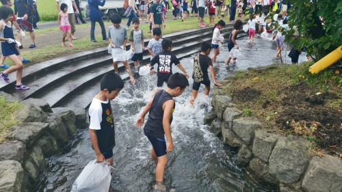 children catching fish at a festival