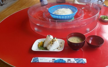 Rice balls, miso soup and chopsticks in somen noodles shop of Ibusuki.