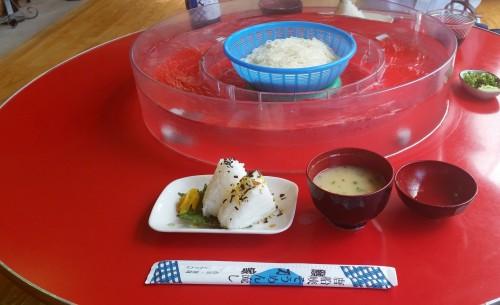Rice balls, miso soup and chopsticks in somen noodles shop of Ibusuki.
