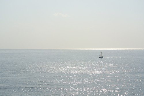 Boat in the water and the horizon at Katsurahama beach in Kochi.